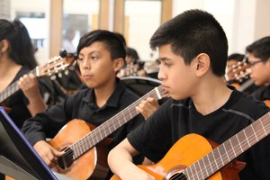 DMS students performing classical guitar.