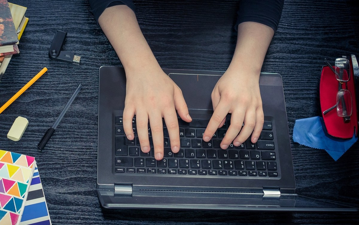Image of hands on laptop keyboard