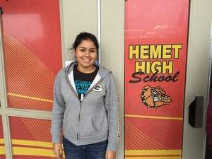 Alma Cervantes-Garcis in front of a Hemet High Bulldog window display.