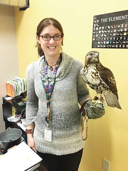 Dr. Campbell-Smith with her red-tailed hawk Hudson.