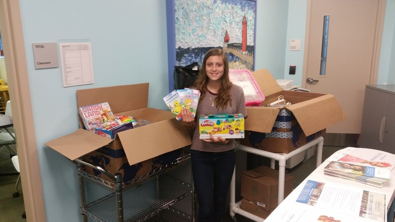 Allison Wilbur donates toys and play items to the children's hospital in Grand Rapids.