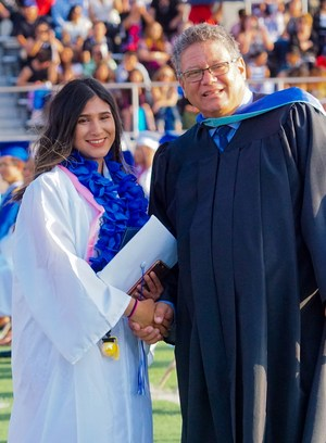 Baldwin Park High Principal Anthony M. Ippolito shakes hands with one of 420 graduates during the school's commencement ceremony on Thursday, June 2, 2016 at the school.