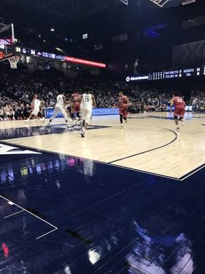 Xavier Basketball players running down the court