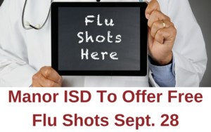 A doctor holding a flu shots here sign =