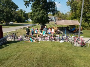 Girl Scouts collecting used bicycles