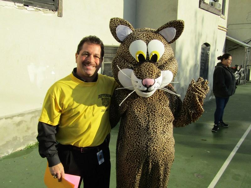 Principal M. Celebrano and the mascott welcoming students