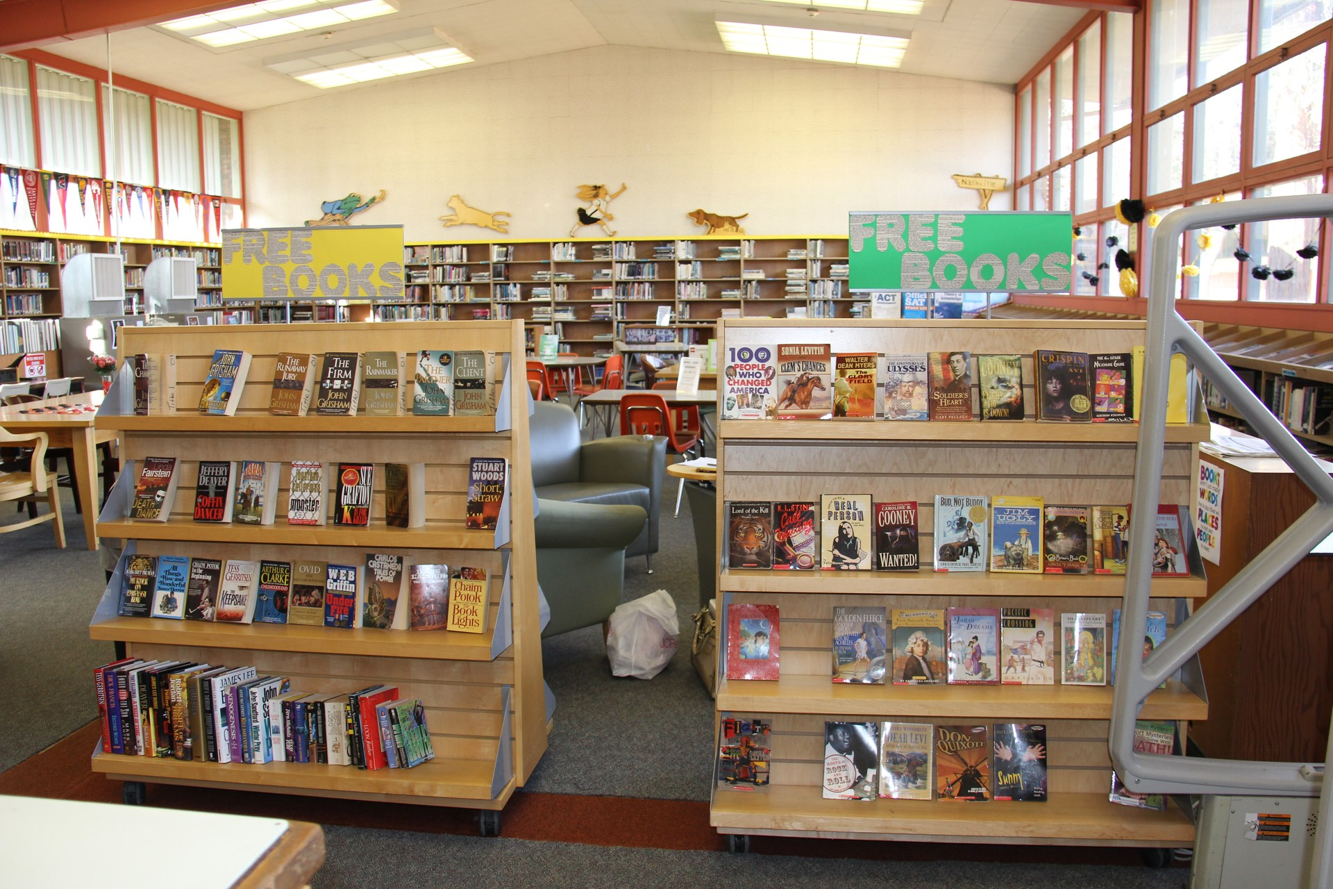 Image of books on Library shelf from entrance