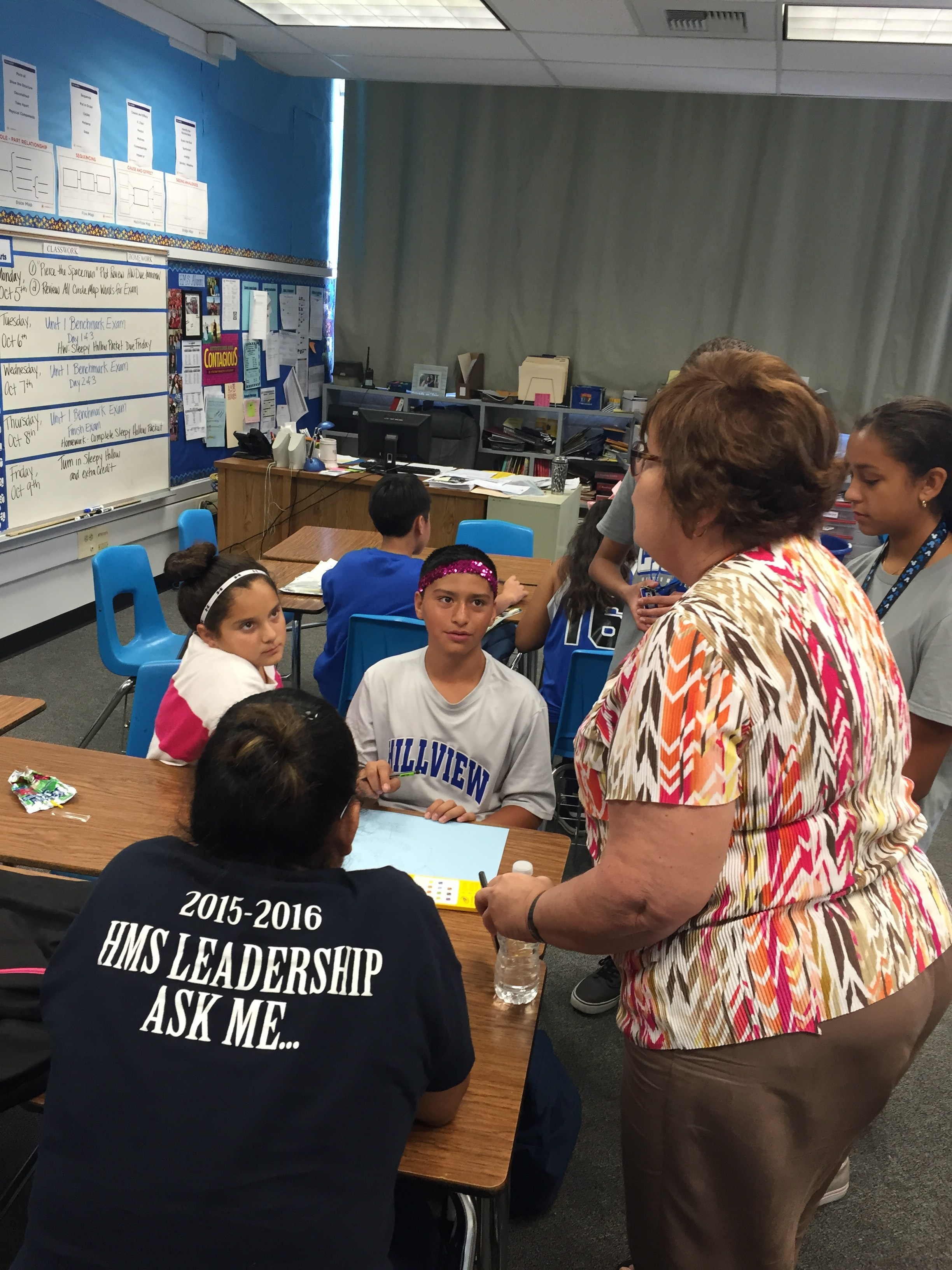 Superintendent, Mary Branca, talking with a group of students