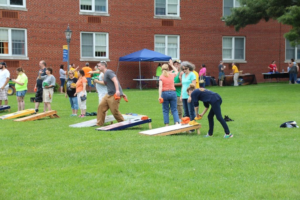 Students and families playing Corn Hole