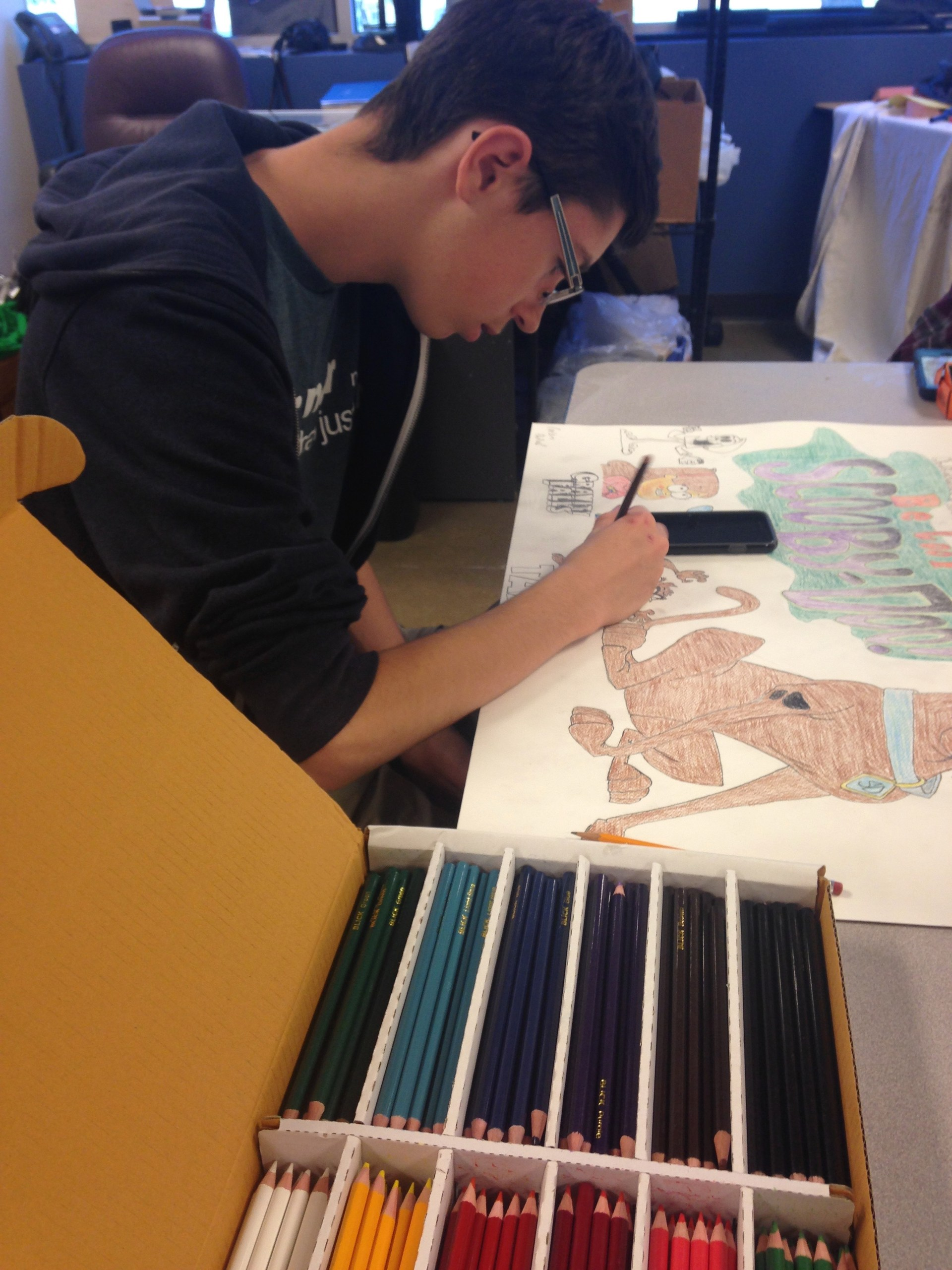 student working on art