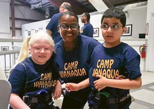 Two campers with their counselor