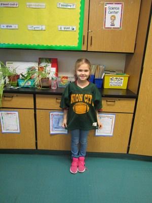 little girl wearing a UC football jersey