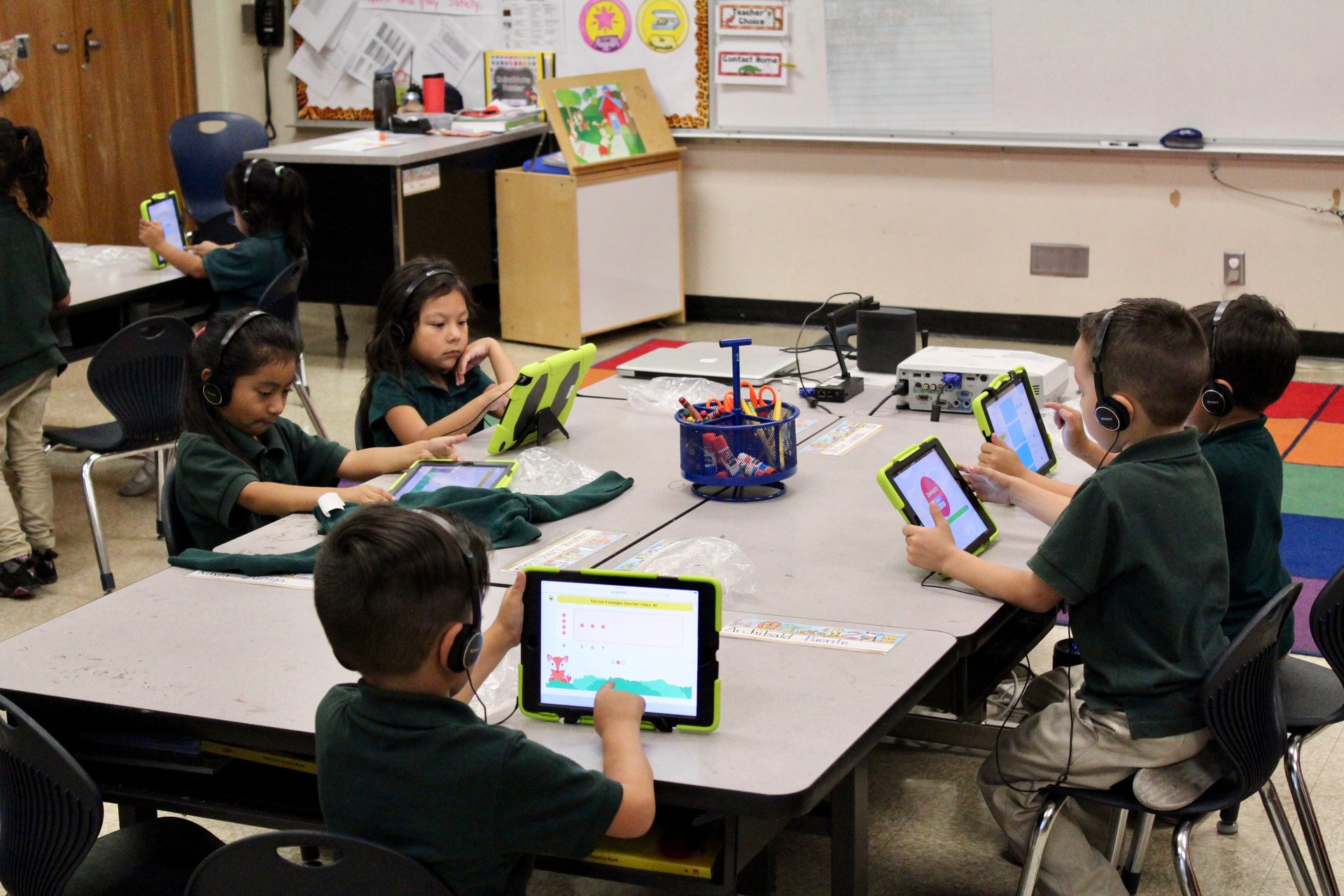 group of students study on iPads