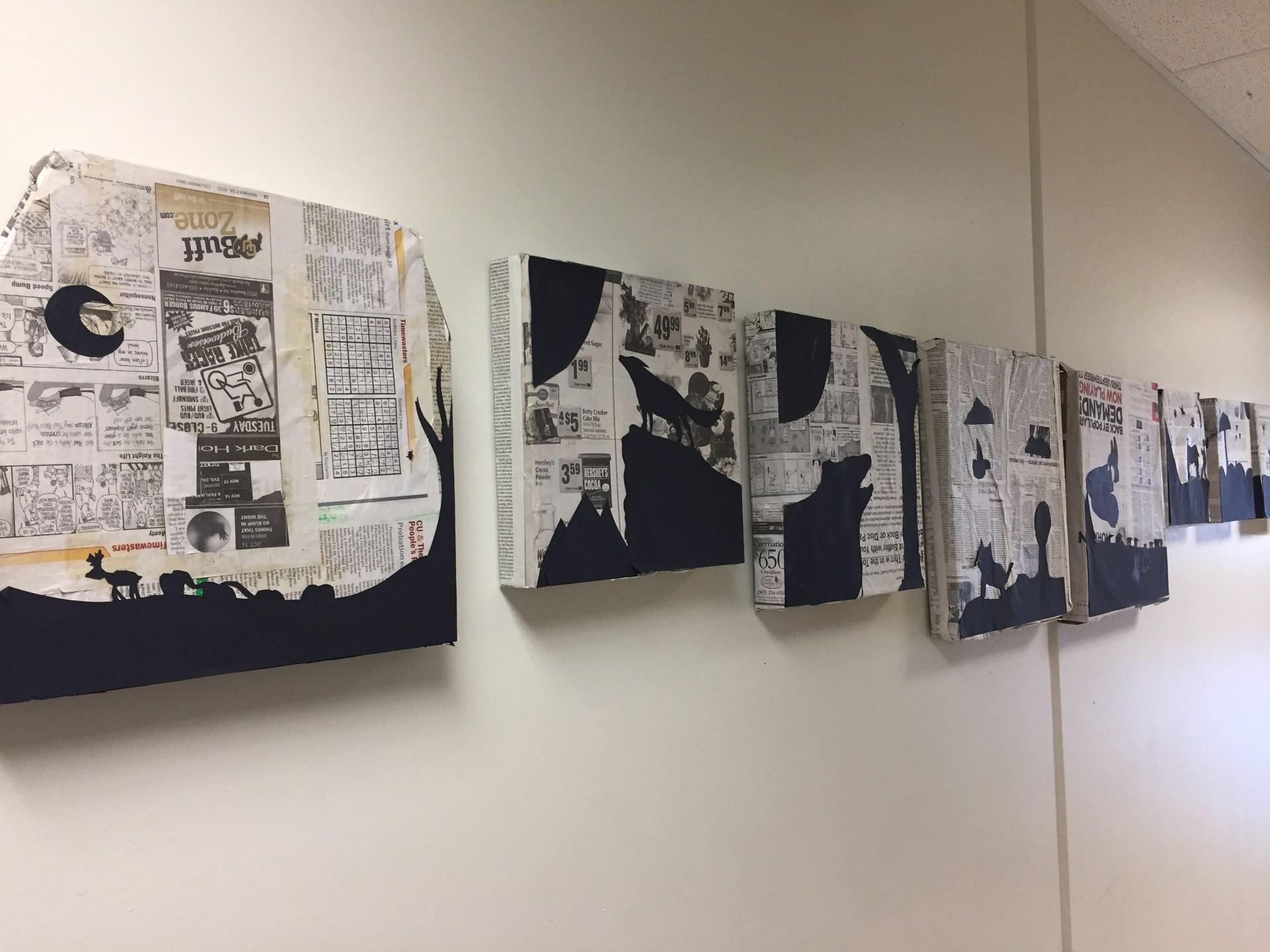 newspaper and black paper artwork
