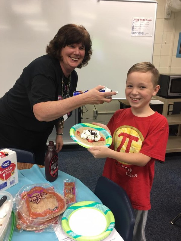 Mrs. Donofrio having fun with students at Cooking Club