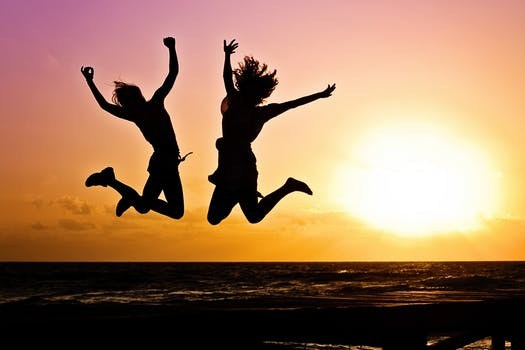 girls jumping in the air