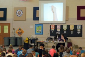 Author Ruth McNally Barshaw draws for students.