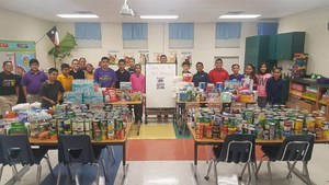 5th Grade students of Landrum Elementary pose with donation items