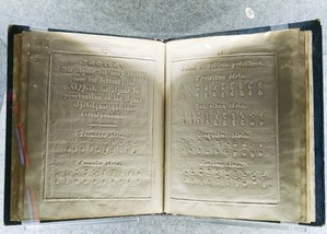 A closeup of Louis Braille's first published braille codebook, 1829.