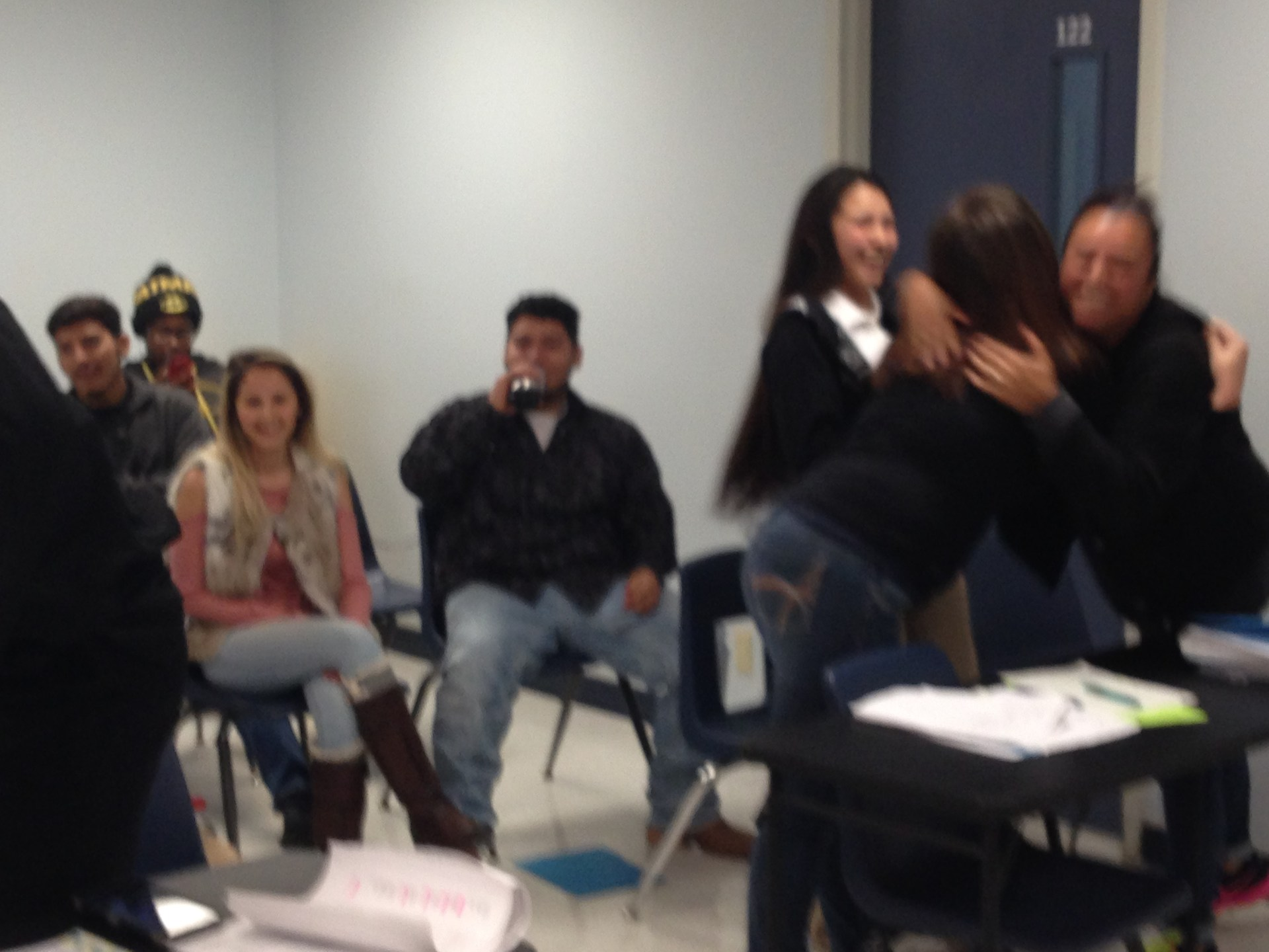 Defendant and attorney's celebrate the reading of the verdict.
