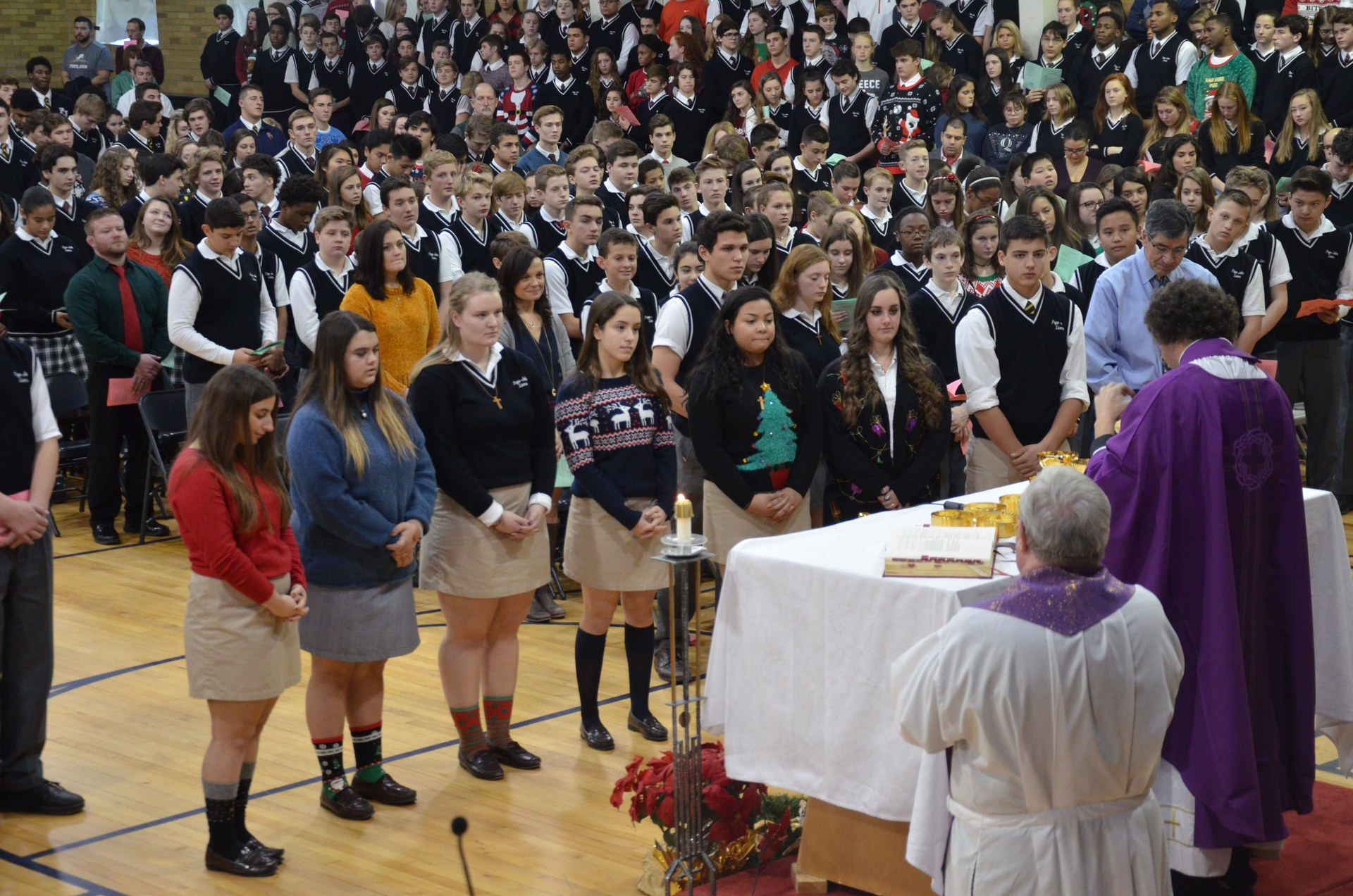 Students surround altar during mass