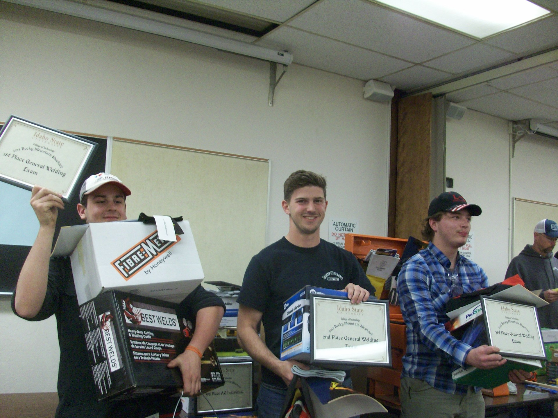 Welding Student hold their prizes