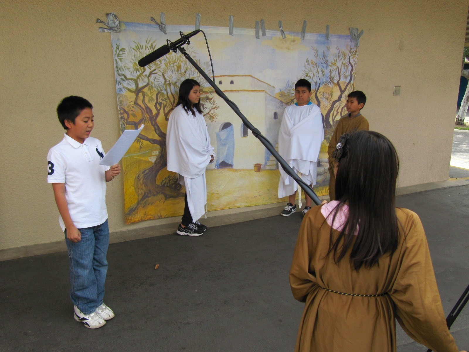 A group of students filming a scene in a movie.