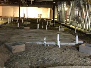 Underground plumbing being installed.