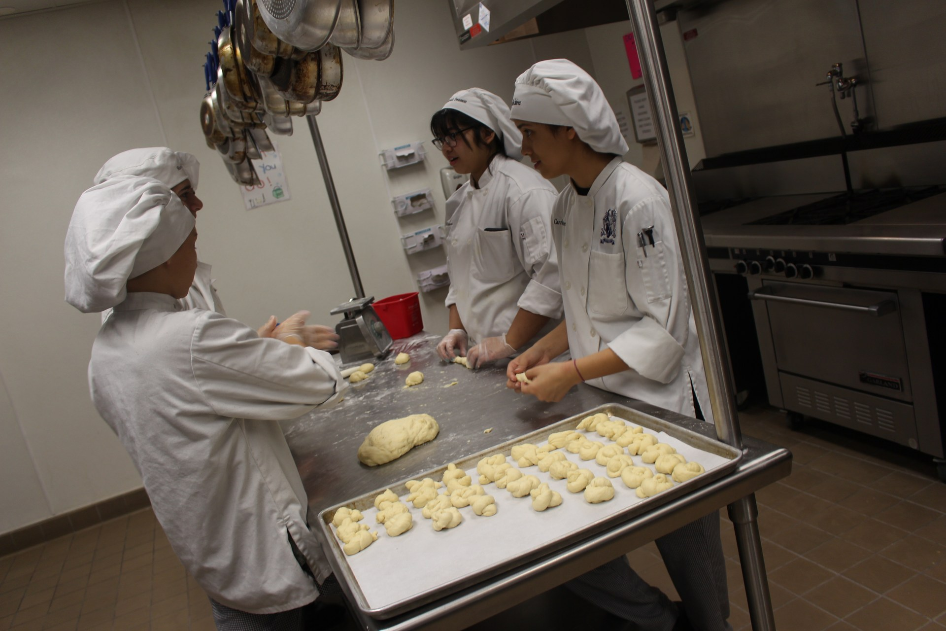Two students working on making rolls