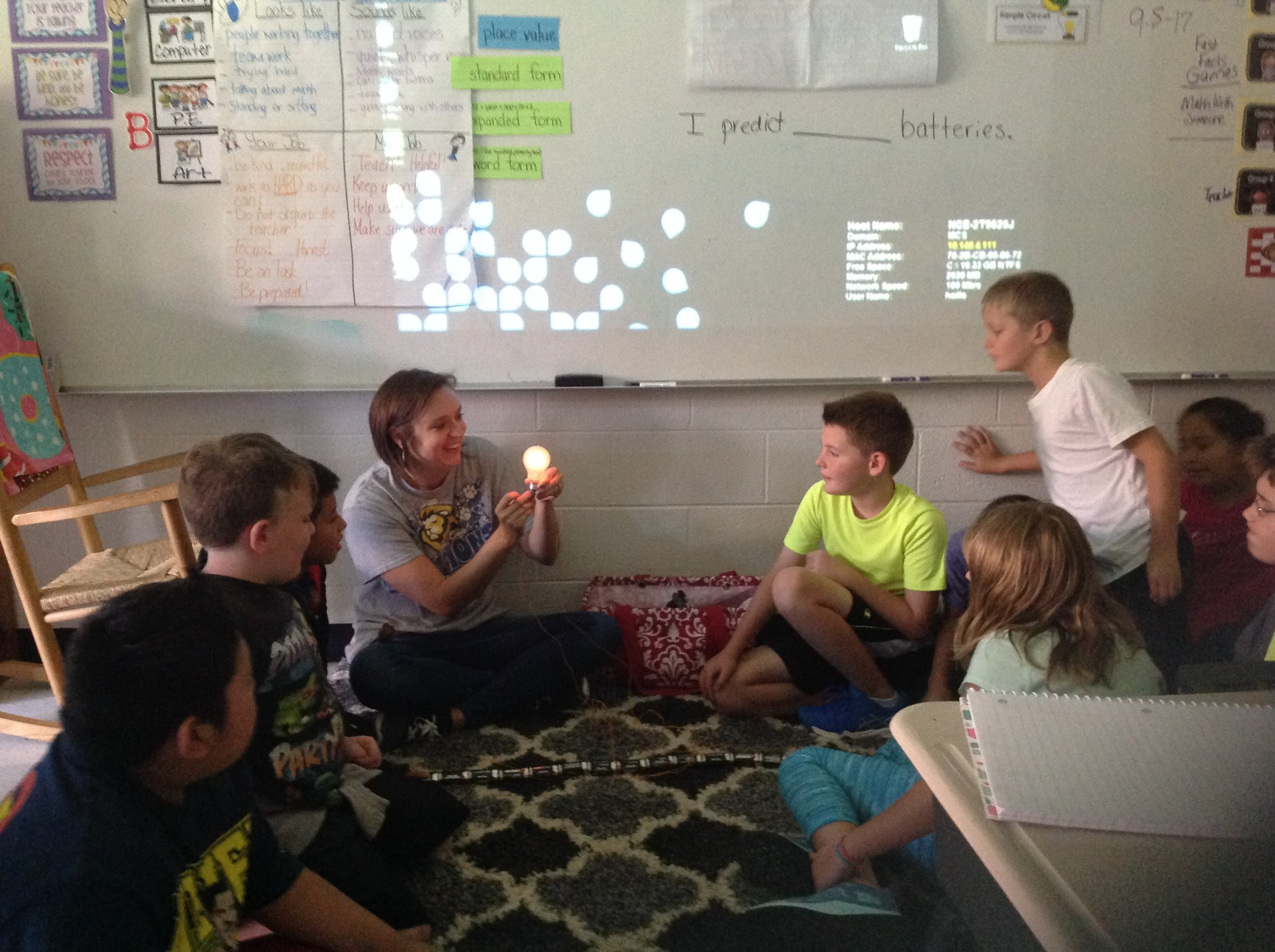 How many batteries will it take to light a regular size light bulb?