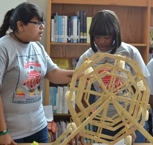Two Students with a Wooden Roller Coaster Display