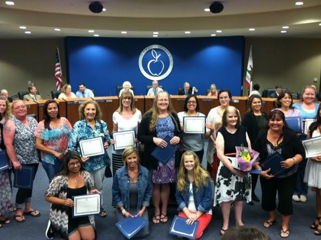 Parent volunteers being recognized at board meeting