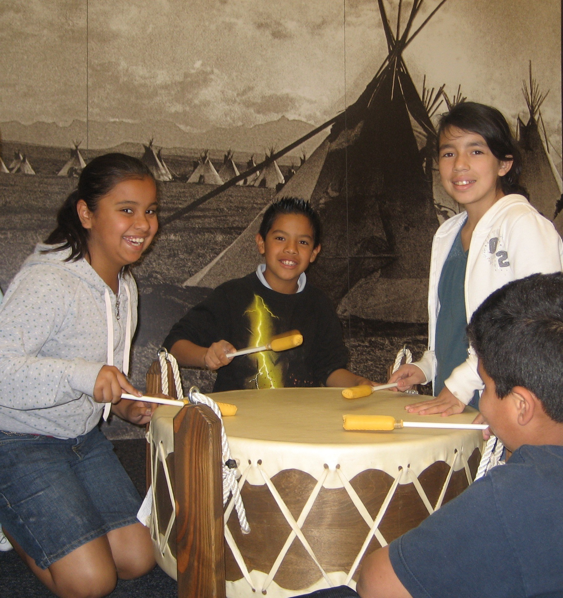 Children at playing the drum in the Creativity Center.
