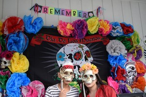 BPUSD_DÍA_2: Two Baldwin Park High students holding traditional skull masks during the school's Nov. 3 Día de Los Muertos event, which had altars honoring individuals such as educator Jaime Escalante, musician Selena Quintanilla-Perez, and actor Roberto Gomez Bolaños, as well as shining a light on social concerns such as bullying and domestic violence.