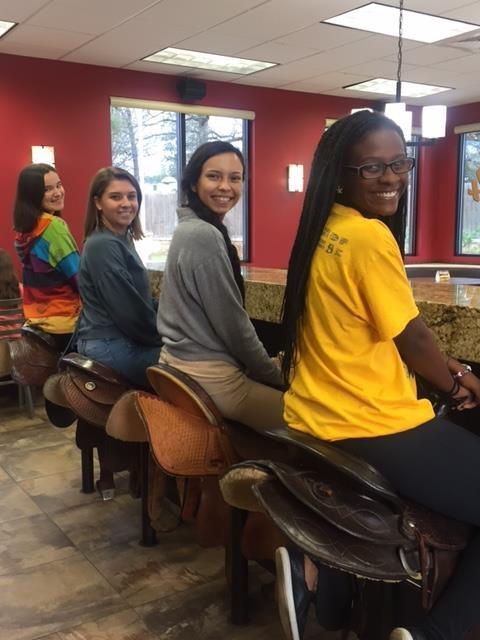 Whataburger sitting on saddles