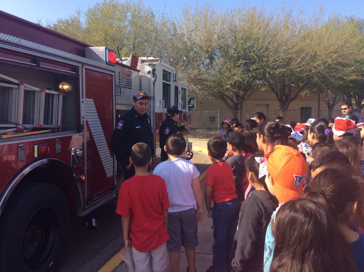 Picture of Fireman showing firetrucks to Kids