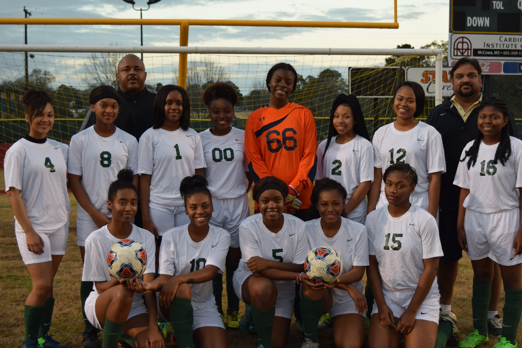 girls soccer team with coaches
