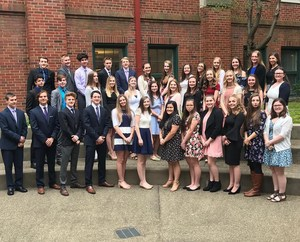 New members of OLSH's chapter of National Honor Society pose in the courtyard