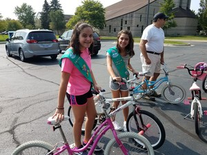 Girl Scouts collecting used bikes