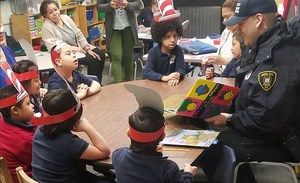 uc police officer reading to students