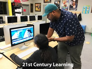 Teacher_Student_Computer_21st Century Learning.jpg