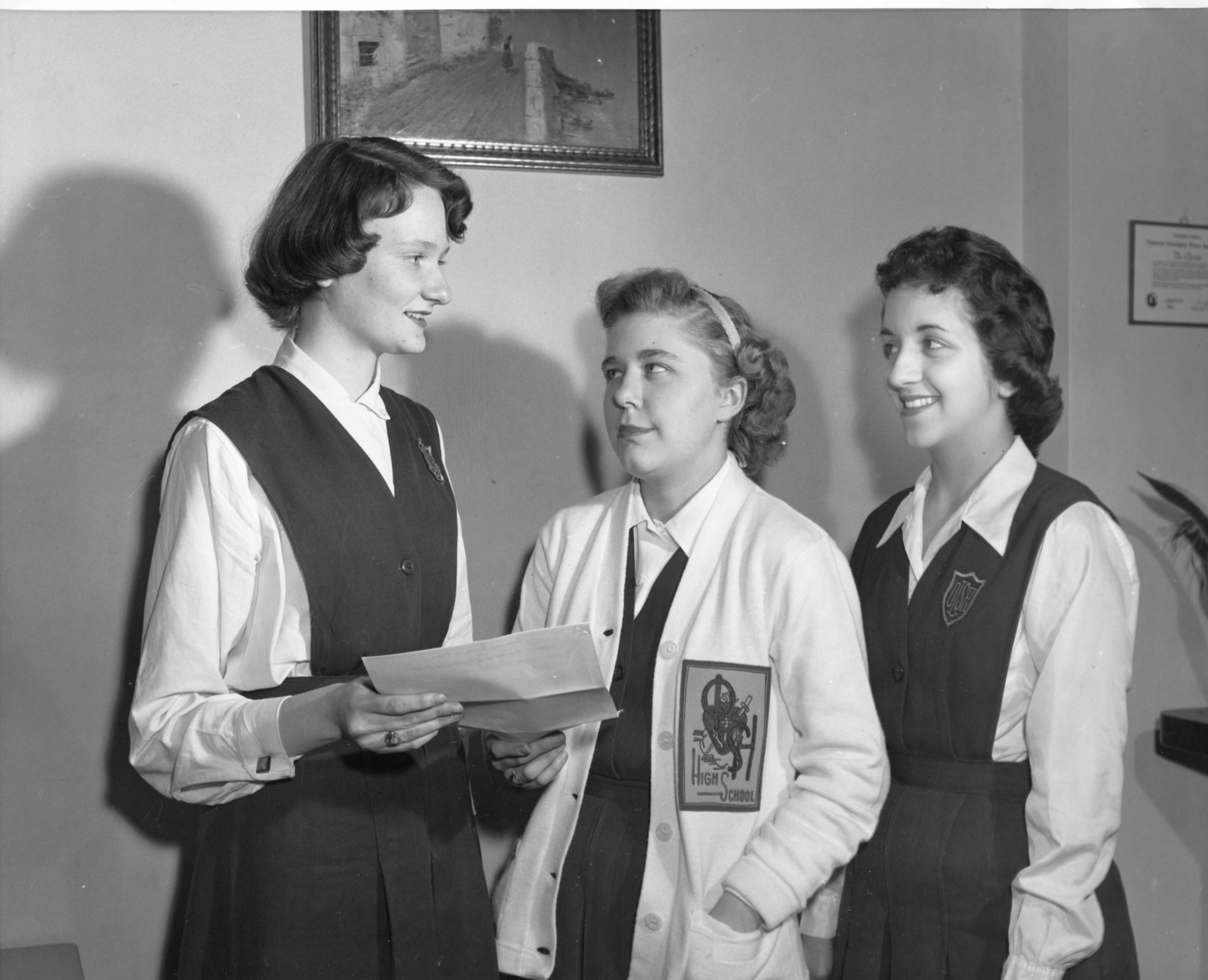 Three young women in the 1950s wearing the OLSH uniform of the time.