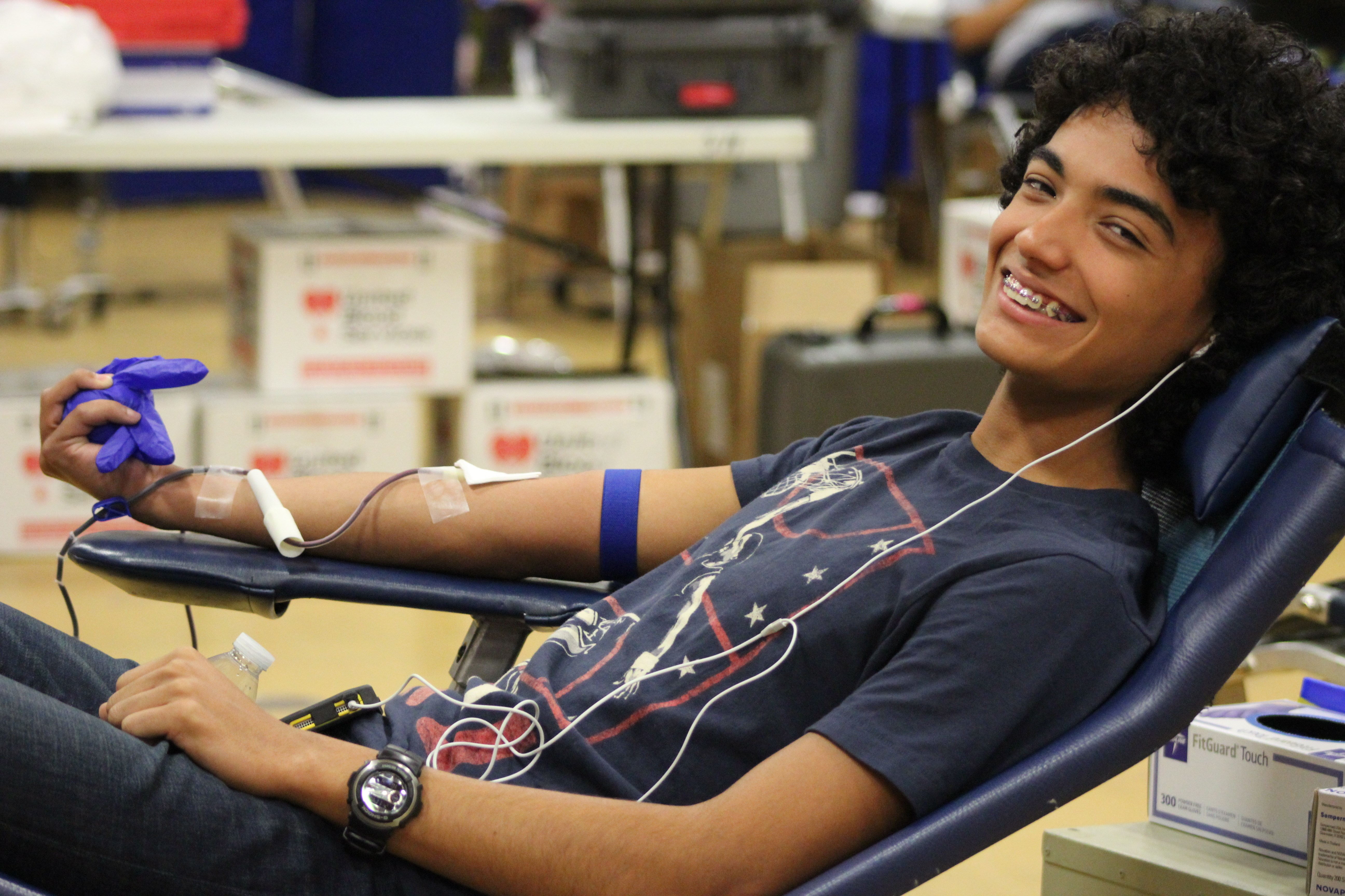 Student donating blood.