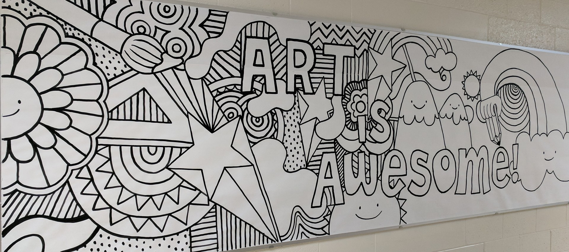 black and white hallway mural that says 'art is awesome' will be painted by art club students.