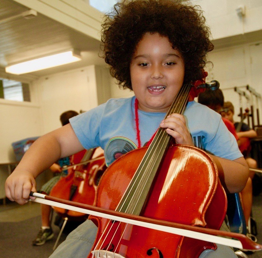 Student playing the cello.