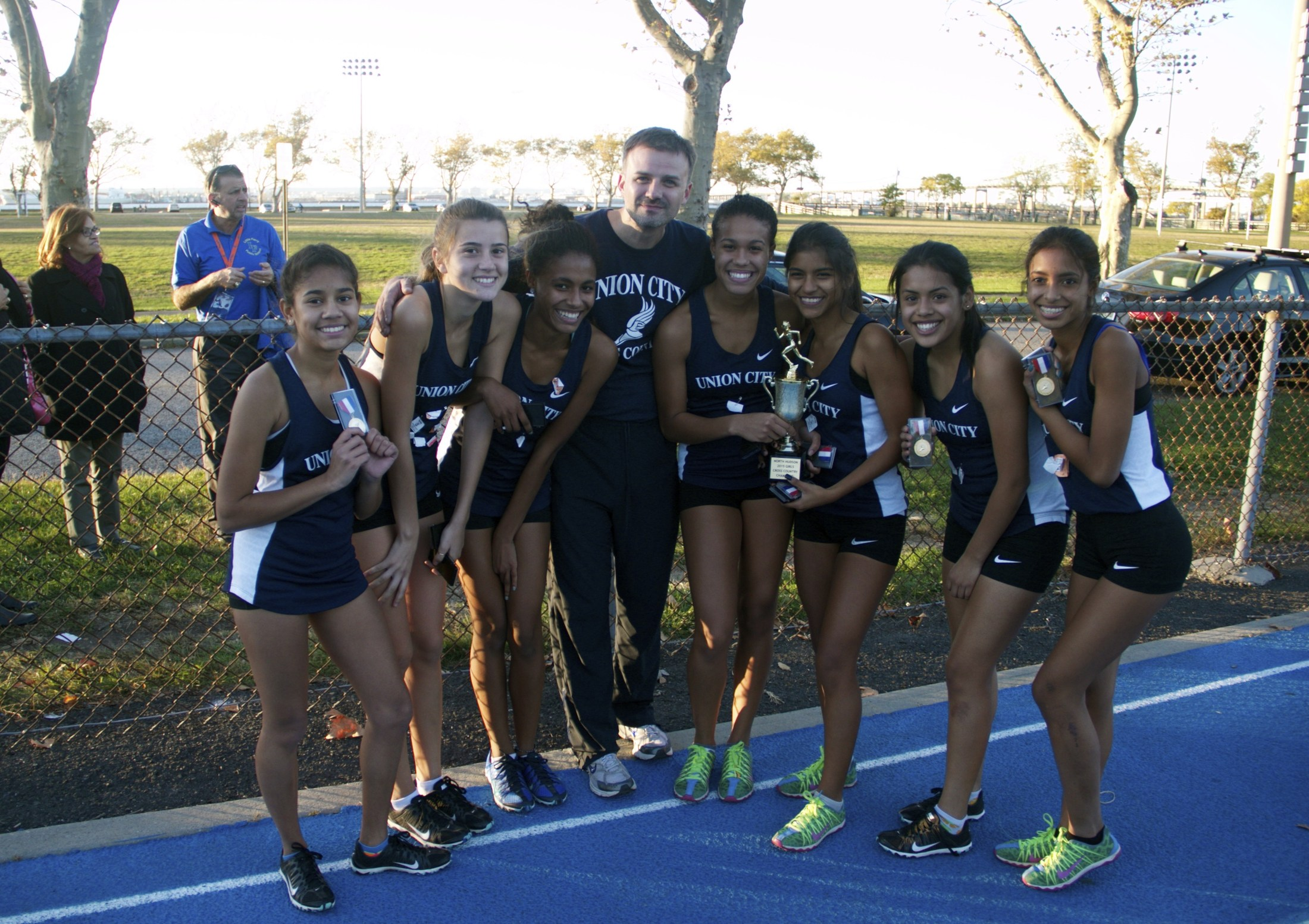girls team with coach at meet