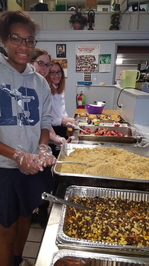 OLSH students serve food at a local soup kitchen.