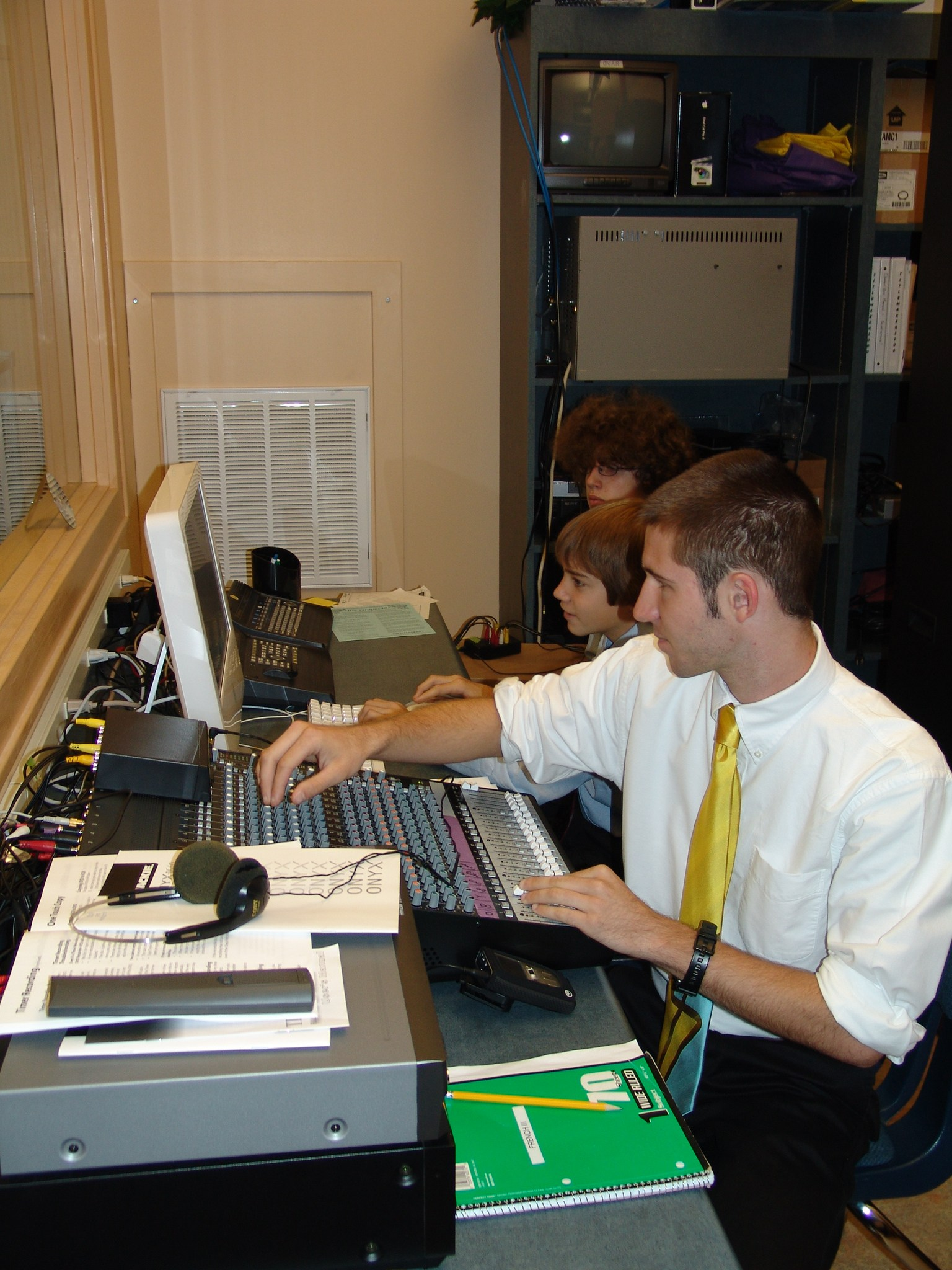 Students operating technical equipment for the WCHR tv studio