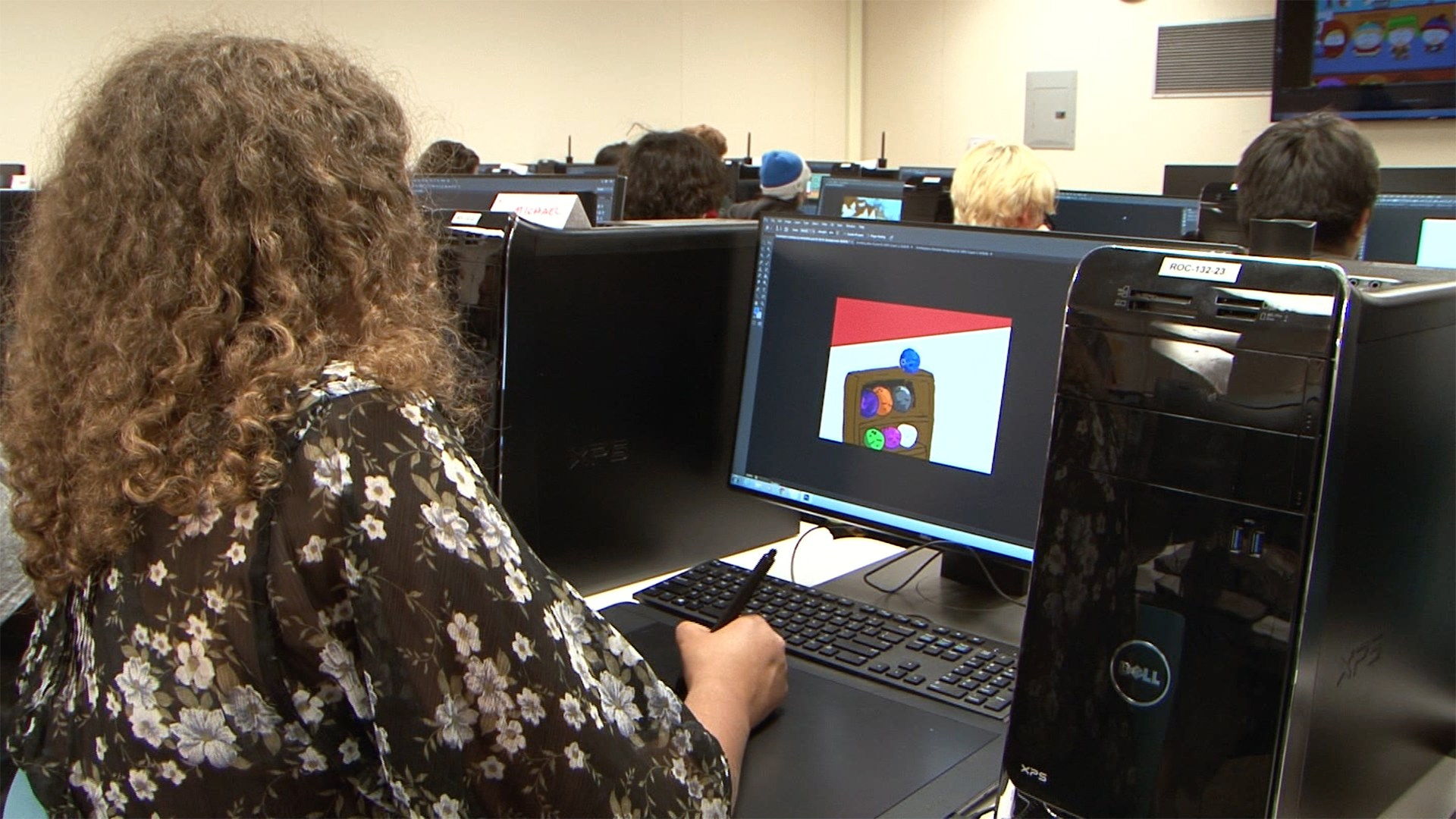 Student working on computer in 3D animation class