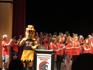 TK teachers and staff get an enthusiastic welcome back to school by the TKHS band and Trojan mascot.
